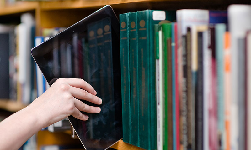 ipad in between books